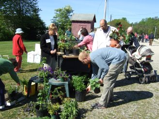 The Club's annual gardeners sale draws customers from far and near.