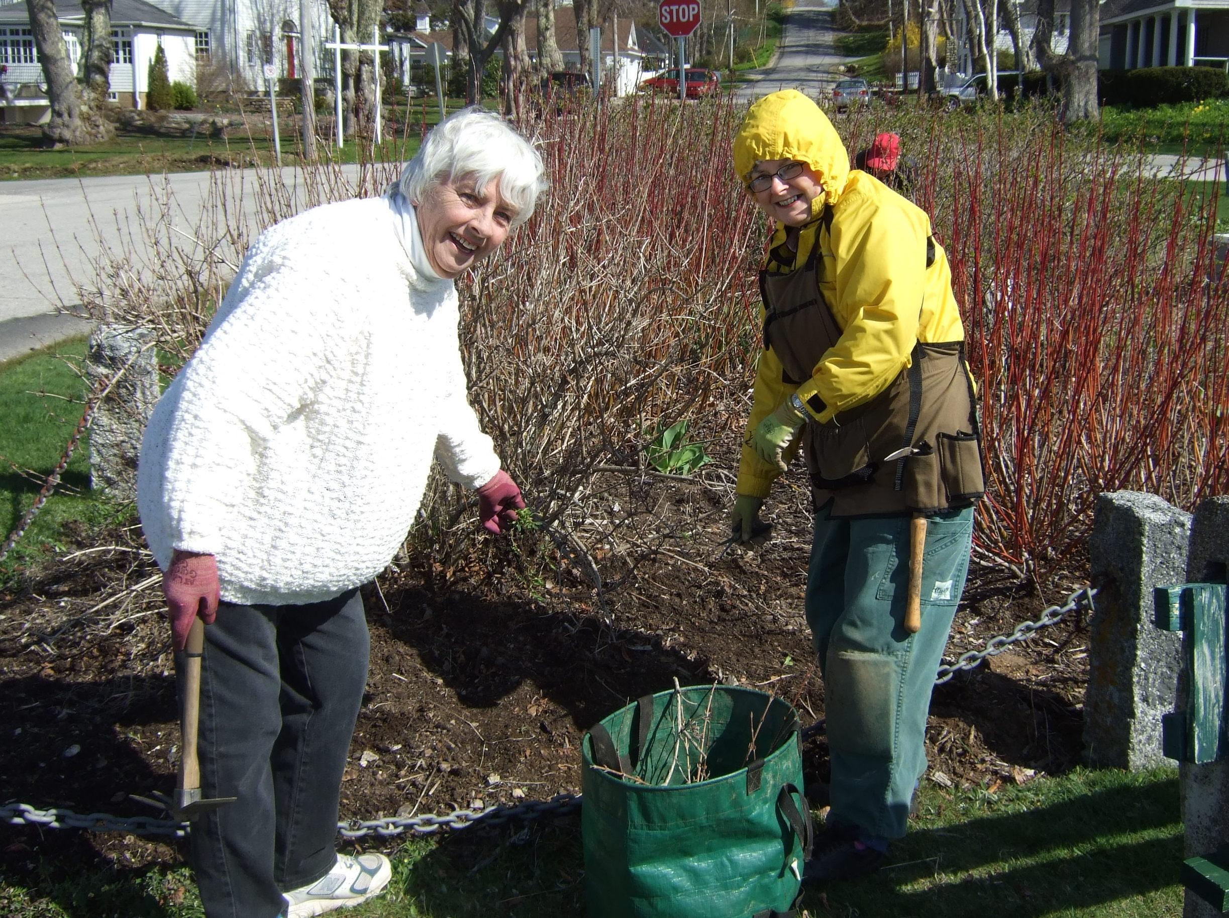 club members edging garden