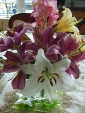 Oriental lilies fittingly grace the table.