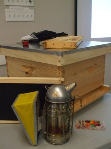 A sample hive, along with accessories needed to gather honey.
