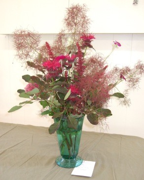 The ethereal appearance of the Smokebush cuttings add a delicacy to this arangement.