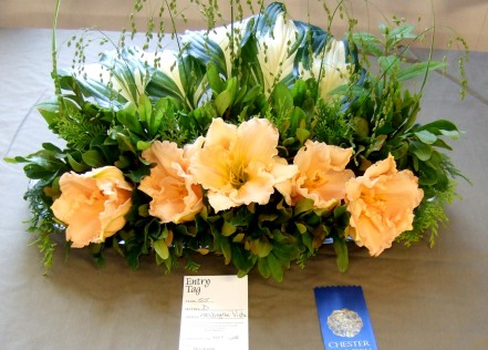 "A soft golden array of daylilies was entered in the ""180 degree Vista"" - designs to be viewed from one side only."