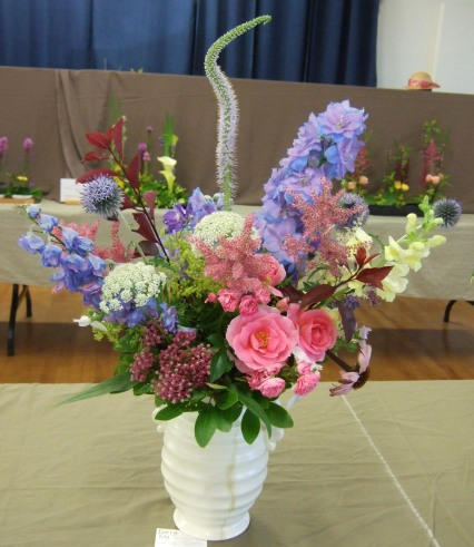 Delphiniums, roses and an eclectic selection of other plants went into this design.