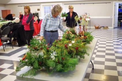 Sue places her arrangement .