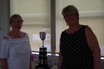 Sylvia receiving Sweet Pea Trophy from Jayne
