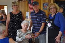Peggy McAlpine Presents a trophy